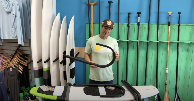Racked ceiling SUP and surf rack