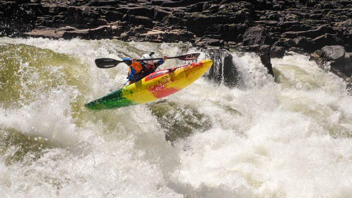 Bren Orton paddles his Pyranha Ripper half slice kayak on the Zambezi river in Africa.